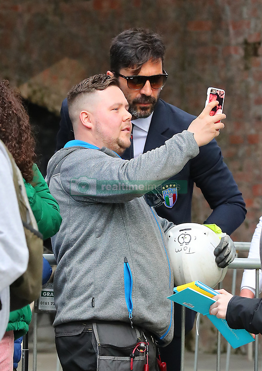 Gianluigi Buffon does a selfie with a builder as the Italy football team leave their Manchester hotel on Monday afternoon and start their journey to London to face England at Wembley tomorrow night