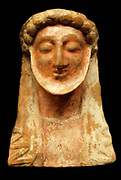 Terracotta protome of a bearded male, perhaps Dionysus, from an Attic or Boeotian workshop c500 BC