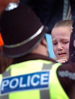 Photo: Leigh Quinnell.<br /> Coventry City v Preston North End. Coca Cola Championship. 01/04/2006. A girl is left in tears as police enter the Coventry area.