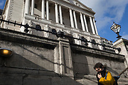 On the day that Chancellor of the Exchequer Rishi Sunak unveiled a £30bn package to boost the economy and get the country through the coronavirus outbreak, a lady descends the steps into Bank Underground Station in the capital's financial district, beneath the walls of the Bank of England as its governor Mark Carney cut the interest rate from 0.75% to 0.25%, on 11th March 2020, in the City of London, England.