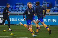 George Lapslie of Mansfield Town (32) in the warm up during the The FA Cup match between Mansfield Town and Dagenham and Redbridge at the One Call Stadium, Mansfield, England on 29 November 2020.