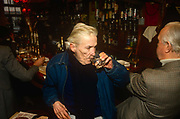 English writer, Jeffrey Barnard drinks at lunchtime in his favoured Coach And Horses pub, in the summer of 1990 in Soho, London, England. Jeffrey Bernard 1932 – 1997 was a British journalist, best known for his weekly column Low Life in The Spectator magazine, and also notorious for a feckless and chaotic career and life of alcohol abuse. He became associated with the louche and bohemian atmosphere that existed in Londons Soho district. He was later immortalised in the comical play Jeffrey Bernard Is Unwell by Keith Waterhouse.