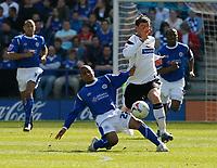 Photo: Steve Bond.<br />Leicester City v Derby County. Coca Cola Championship. 06/04/2007. Levi Porter (L) tackles Darren Currie (R)