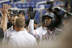 August 31, 2017 - Miami, FL, USA - The Miami Marlins' Marcell Ozuna is congratulated by teammates after scoring during the third inning against the Philadelphia Phillies at Marlins Park in Miami on Thursday, Aug. 31, 2017. The Phillies won, 3-2. (Credit Image: © David Santiago/TNS via ZUMA Wire)