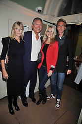 Left to right, CHARLES & PANDORA DELEVINGNE, POPPY DELEVINGNE and JAMES COOK at the launch of Quintessentially Soho at the House of St Barnabas, 1 Greek Street, London on 29th September 2009.<br /> <br /> <br /> <br /> <br /> BYLINE MUST READ: donfeatures.com<br /> <br /> *THIS IMAGE IS STRICTLY FOR PAPER, MAGAZINE AND TV USE ONLY - NO WEB ALLOWED USAGE UNLESS PREVIOUSLY AGREED. PLEASE TELEPHONE 07092 235465 FOR THE UK OFFICE.*