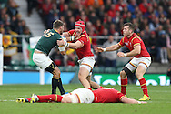 Tyler Morgan of Wales tackles Willie Le Roux of South Africa. Rugby World Cup 2015 quarter final match, South Africa v Wales at Twickenham Stadium in London, England  on Saturday 17th October 2015.<br /> pic by  John Patrick Fletcher, Andrew Orchard sports photography.