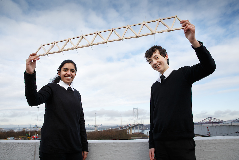 """FREE PICTURES- A new YESC project sponsored by Morrison Construction titled """"Go Forth!"""". The project is challenging science clubs across Scotland to create a suspension bridge, inspired by the Queensferry Crossing, which will then be tested at the YESC regional and national celebrations. <br /> SCDI's Young Engineers and Science Clubs (YESC) Scotland has created an exciting new engineering project inspired by the Queensferry Crossing – the Go Forth! Challenge. Over 300 schools across Scotland, from Shetland to Dumfries, are receiving free kits containing all they need to design and build a suspension or cable-stayed bridge. <br /> Pupils from Trinity Academy , Edinburgh with the beginnings of their bridge. In the background is the Queensferry and Forth Rd bridges. L to R: Shumaila Anwar and Sean Mclean.<br /> Picture Robert Perry 26th Feb 2016<br /> <br /> Please credit photo to Robert Perry<br /> <br /> Image is free to use in connection with the promotion of the above company or organisation. 'Permissions for ALL other uses need to be sought and payment make be required.<br /> <br /> <br /> Note to Editors:  This image is free to be used editorially in the promotion of the above company or organisation.  Without prejudice ALL other licences without prior consent will be deemed a breach of copyright under the 1988. Copyright Design and Patents Act  and will be subject to payment or legal action, where appropriate.<br /> www.robertperry.co.uk<br /> NB -This image is not to be distributed without the prior consent of the copyright holder.<br /> in using this image you agree to abide by terms and conditions as stated in this caption.<br /> All monies payable to Robert Perry<br /> <br /> (PLEASE DO NOT REMOVE THIS CAPTION)<br /> This image is intended for Editorial use (e.g. news). Any commercial or promotional use requires additional clearance. <br /> Copyright 2016 All rights protected.<br /> first use only<br /> contact details<br /> Robert Perry     <br /> 07702 63"""
