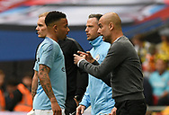 Manchester City manager Pep Guardiola talks to Gabriel Jesus (33) of Manchester City after City score the opening goal during the The FA Cup Final match between Manchester City and Watford at Wembley Stadium, London, England on 18 May 2019.