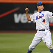 Wilmer Flores, New York Mets, loses control of the ball as he attempts to throw to first during the New York Mets Vs St. Louis Cardinals MLB regular season baseball game at Citi Field, Queens, New York. USA. 19th May 2015. Photo Tim Clayton