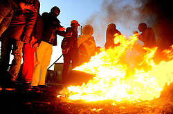 South Africa - Johannesburg - 14 July 2020 - Residents of Protea South Soweto gather around a fire to warm themselves as temperatures in Gauteng are expected to be at their lowest in the coming days with most parts of the province reaching a maximum below 10 degrees. Picture: Nokuthula Mbatha/African News Agency(ANA)