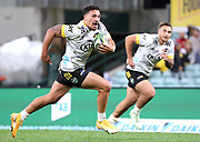 Billy Proctor (L) of the Wellington Hurricanes runs to score a try during the Round 1 Trans-Tasman Super Rugby match between the NSW Waratahs and the Wellington Hurricanes at the SCG in Sydney, Friday, May 14, 2021.  (AAP Image/David Gray) NO ARCHIVING, EDITORIAL USE ONLY