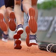 PARIS, FRANCE May 26. Ball boys and ball girls leave the stadium during change over on Court Philippe-Chatrier  at the 2019 French Open Tennis Tournament at Roland Garros on May 26th 2019 in Paris, France. (Photo by Tim Clayton/Corbis via Getty Images)