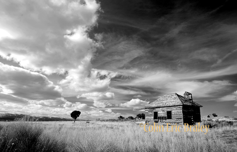 A log school house is the only structure that remains of a Ghost Town in central Utah. Colin Braley/wildweststock.com