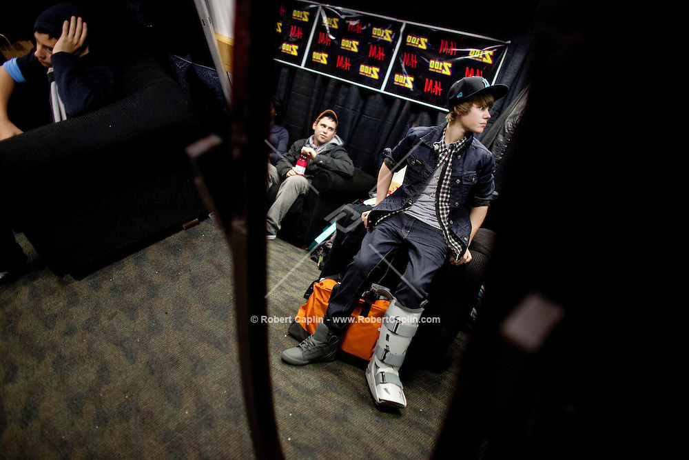 Justin Bieber and Usher do vocal warm-ups in their dressing room prior to performing at the 2009 Z100's Jingle Ball at Madison Square Garden in New York. ..(Photo by Robert Caplin).....