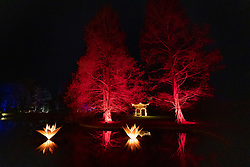 © Licensed to London News Pictures. 30/11/2018. London, UK. The Pagoda wrapped in tiny lights and flood lit in red at RHS Wisley Gardens. Trees and plants have been illuminated at Royal Horticulture Society Wisley Gardens for the Christmas Glow seasonal event. Hundreds of different lights can be seen when following the trail throughout the gardens opening 1 December 2018 2 January 2019. Photo credit: Peter Macdiarmid/LNP