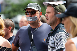"""A man has his mouth taped closed in protest against a perceived lack of freedom of speech as several hundred protesters in London in central London demand the release of """"political prisoner"""" right wing talisman Stephen Yaxley-Lennon  - also known as Tommy Robinson, who was imprisoned for contempt of court. London, August 03 2019."""