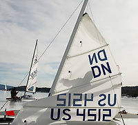 Setting up the rigging of a DN ice sailing boat with the New England Yacht Association at the Ames Farm Inn beach.  (Karen Bobotas Photographer)
