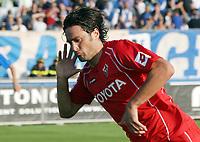 """L'esultanza di Luca Toni dopo il gol del 2-1<br /> Luca Toni celebrates after scoring gol for Fiorentina<br /> Italian """"Serie A"""" 2006-07<br /> 15 Oct 2006 (match 6)<br /> Empoli-Fiorentina 1-2<br /> """"Castellani"""" Stadium-Empoli-Italy<br /> Photographer Luca Pagliaricci INSIDE"""