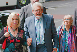 London, June 6th 2014. Entertainer and artist Rolf Harris arrives at Court with his daughter Bindi, left and his wife Alwen, as his trial on 12 counts of indecent assault against 4 girls aged 7 to 19 continues.