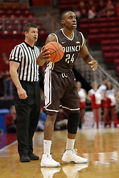 27 November 2015: Godson Eneogwe. Referee Jeff Campbell. Illinois State Redbirds host the Quincy Hawks at Redbird Arena in Normal Illinois (Photo by Alan Look)