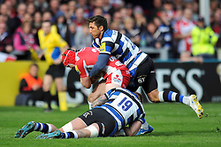 Rob Cook (Gloucester) is double-tackled by Dave Attwood and Gavin Henson (Bath) - Photo mandatory by-line: Patrick Khachfe/JMP - Tel: Mobile: 07966 386802 12/04/2014 - SPORT - RUGBY UNION - Kingsholm Stadium, Gloucester - Gloucester Rugby v Bath Rugby - Aviva Premiership.