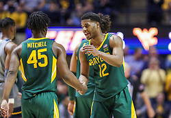 Mar 7, 2020; Morgantown, West Virginia, USA; Baylor Bears guard Jared Butler (12) talks with Baylor Bears guard Davion Mitchell (45) during the first half against the West Virginia Mountaineers at WVU Coliseum. Mandatory Credit: Ben Queen-USA TODAY Sports