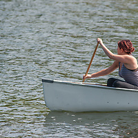 Courtney Smith paddles a canoe on Lake of the Woods, Ontario, Canada.
