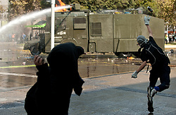Protesting students throw stones at riot police during a march in Santiago, capital of Chile, on April 16, 2015. The march was held to demand the government fulfill its promise of free higer education, according to the organizers. EXPA Pictures © 2015, PhotoCredit: EXPA/ Photoshot/ [e]JORGE VILLEGAS<br /> <br /> *****ATTENTION - for AUT, SLO, CRO, SRB, BIH, MAZ only*****