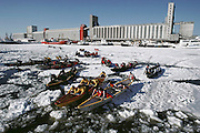 Canoe race across the frozen St. Laurence seaway during winter carnival. Quebec, Canada.