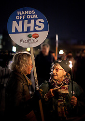 © Licensed to London News Pictures .Women demonstrate as the People's Assembly call for a day of national action and march along Westminster Bridge to protest against rising energy bills and cuts in the NHS. (05/11/2013) . Photo credit : Isabel Infantes /LNP