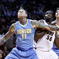 19 March 2011: Denver Nuggets center Chris Andersen (11) vies for the rebound with Miami Heat center Joel Anthony (50) and Denver Nuggets forward Danilo Gallinari (8)  during the Miami Heat 103-98 victory over the Denver Nuggets at the AmericanAirlines Arena, Miami, Florida, USA.