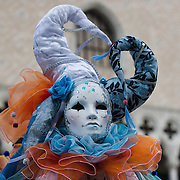VENICE, ITALY - FEBRUARY 11:  A woman wearing a Carnival masks poses for pictures in front of Palazzo Ducale in St. Mark's Square on February 11, 2012 in Venice, Italy.The annual festival, which lasts nearly three weeks, will see the streets and canals of Venice filled with people wearing highly-decorative and imaginative carnival costumes and masks.