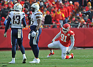 KANSAS CITY, MO - NOVEMBER 24:  Defensive end Tamba Hali #91 of the Kansas City Chiefs kneels on the ground, after hurting his right leg against the San Diego Chargers during the first half on November 24, 2013 at Arrowhead Stadium in Kansas City, Missouri.  (Photo by Peter Aiken/Getty Images) *** Local Caption *** Tamba Hali