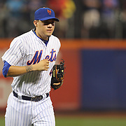 Wilmer Flores, New York Mets, returns to the dugout crying while fielding at short stop after learning he had been traded to the Milwaukee Brewers during the game. The trade subsequently fell through. New York Mets Vs San Diego Padres MLB regular season baseball game at Citi Field, Queens, New York. USA. 29th July 2015. Photo Tim Clayton