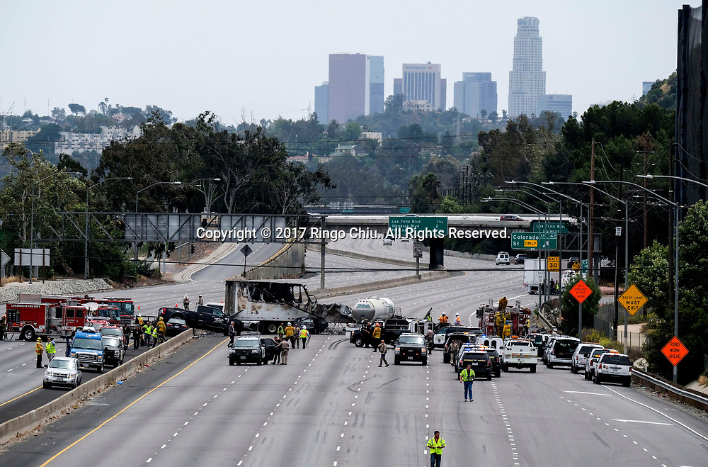 The scene after a multi-vehicle crash on  5 Freeway near Griffith Park, Tuesday, April. 25, 2017, in Los Angeles, the United States. A fiery crash involving two big rigs and multiple passenger vehicles left one person dead and nine others injured, one critically, and forced the closure of the Golden State (5) Freeway in both directions. (Photo by Ringo Chiu/PHOTOFORMULA.com)<br /> <br /> Usage Notes: This content is intended for editorial use only. For other uses, additional clearances may be required.