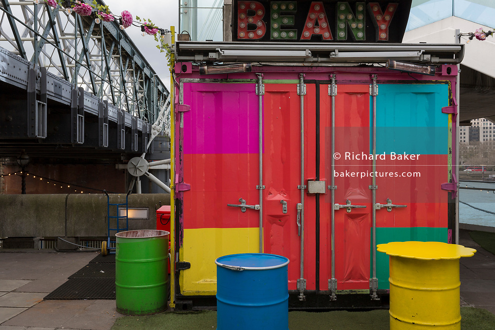 As the UK government announces further Coronavirus-related restrictions to its citizens, with the immediate closure of pubs, cafes, gyms and cinemas, and the worldwide number of deaths reaching 10,000 with 240,000 cases, 953 of those in London alone, a street food vendor remains shut on the Southbank, on 20th March 2020, in London, England.