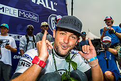 """HUNTINGTON BEACH, California/USA (Sunday, July 28, 2013) - Brazilian Pro Surfer Alejo Muniz (BRA) defeated local favorite Kolohe Andino of San Clemente (USA) to win the Vans US Open in 2- to 3-feet high waves. Alejo scored a total of 16.24 points against Kolohe score of 15.54. """"I cannot believe this,"""" said Alejo Muniz immediately following his victory. He dedicated the win to his late grandparents.  PHOTO © Eduardo E. Silva/SILVEXPHOTO.COM."""