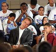 Governor Arnold Schwarzenegger is seen while waiting to be the ninth speaker during a press conference for the After School Program at the Harlem Dowling School in Harlem, NY.