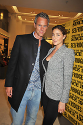 MARK FOSTER and LISA SNOWDON at the launch of Tom Parker Bowles's new book 'Full English' held in the Gallery Restaurant, Selfridges, Oxford Street, London on 9th September 2009.