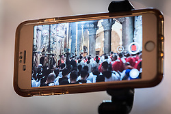14 April 2019, Jerusalem: A person records video as the Latin Patriarchate of Jerusalem celebrates Palm Sunday in the Church of the Holy Sepulchre.