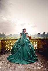 Bride in her wedding dress on the balcony of Eynshsm Hall