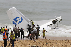 October 14 2017 - Cote d'Ivoire Abidjan. A cargo plane has crashed into the sea off Ivory Coast, close to Abidjan airport, killing four people and injuring six. The wreckage of the turboprop plane, which was carrying ten people, was swept toward a beach where rescuers treated surviving crewmen on the sand. All four of the dead are Moldovan while four French nationals and two Moldovans were injured. (Credit Image: © Legnan Koula/Xinhua via ZUMA Wire)