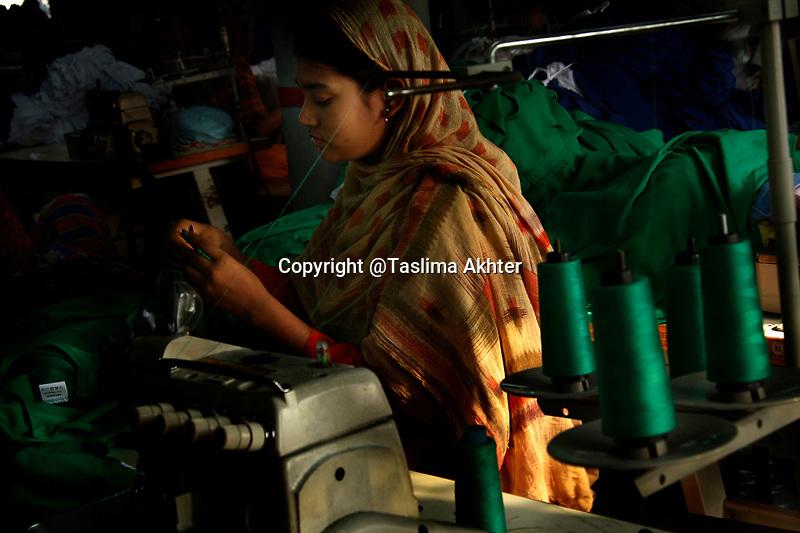 Garment worker at her working place. 16 th May, 2008, Narayangonz, Bangladesh