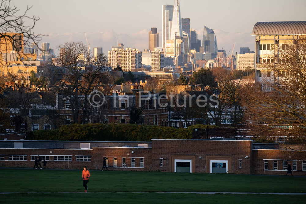 South Londoners out for a late-afternoon walk, enjoy the last sunlight during the second lockdown of the Cornavirus pandemic, in Brockwell Park, Herne Hill, on 19th November 2020, in Lambeth, London, England.