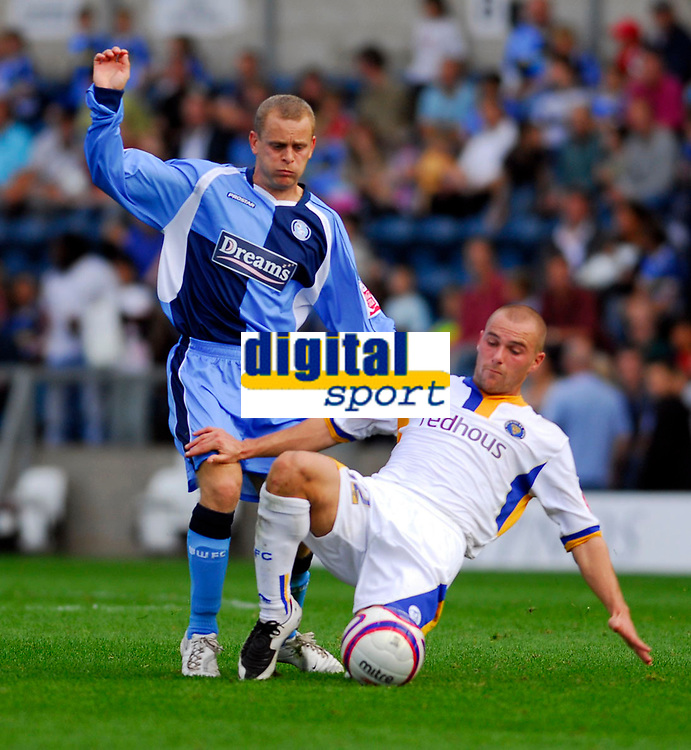 Photo: Leigh Quinnell.<br /> Wycombe Wanderers v Shrewsbury. Coca Cola League 2. 22/09/2007. Wycombes Martin Bullock comes under attack from Shrewsburys Ben Hurd.