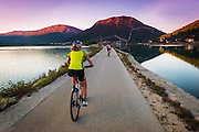 Cyclists on the causeway above the Adriatic, Ston, Dalmatian Coast, Croatia