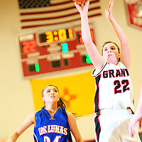 12513  Adron Gardner<br /> <br /> Grants Pirate Haley Hall (22) fires a field goal ahead of Los Lunas Tiger Elise Tapia (24) at Grants High School in Grants Friday.