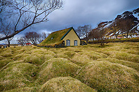 Grass Covered Unmarked Graves Surrounding the Sod Covered Hofskirija in Eastern Iceland. Composite of 3 images taken with a Fuji X-T1 camera and Zeiss 12 mm f/2.8 lens (ISO 200, 12 mm, f/16, 1/20, 1/40, 1/60 sec). Image processed using Google HDR Efex Pro.