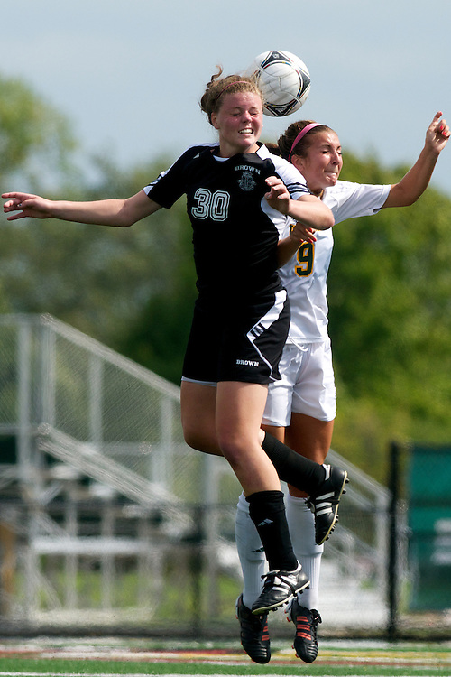 Vermont midfielder Jess Herbst (9) leaps for the header during the women's soccer game between the Brown Bears and the Vermont Catamounts at Virtue Field on Saturday afternoon September 8, 2012 in Burlington, Vermont.