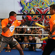 KISSIMMEE, FL - OCTOBER 05: Puerto Rican boxer Felix Verdejo (L) and his trainer Ricky Marquez are seen in the ring as they train during a media workout event at the Kissimmee Boxing Gym on October 4, 2015 in Kissimmee, Florida. Verdejo is returning from a hand injury and announced his next fight will take place in Kissimmee on October 31. (Photo by Alex Menendez/Getty Images) *** Local Caption *** Felix Verdejo; Ricky Marquez